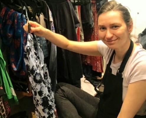 Olena Dibrivna of Harmony Home Organizing decluttering a closet